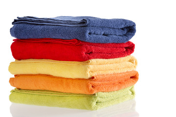 Pile of neatly folded colorful cotton towels