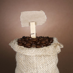 Coffee beans in sack with a price tag