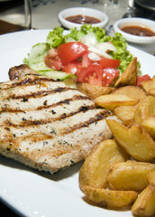 Polish style grilled pork chops meal as photographed in Krakow P