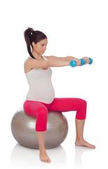 Beautiful pregnant woman doing sport