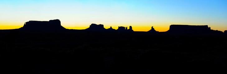 panoramic Monument Valley sunrise silhouette, Navajo Nation Park