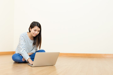 Asia woman using computer at home