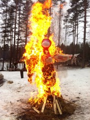 burning a scarecrow-idol to celebrate Carnival