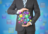 Businessman in a suit holding a app icons