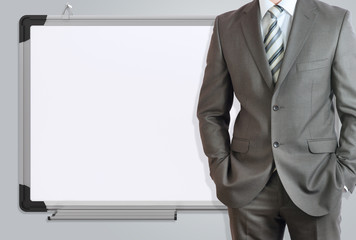 Man in suit and office board