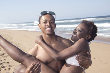 Black boyfriend and girlfriend in his arms