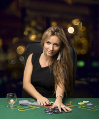 blond girl in a casino playing poker, bokeh