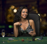 brunette girl in the casino playing poker, bokeh