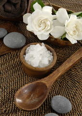 spa salt in bowl and gardenia and stones on mat