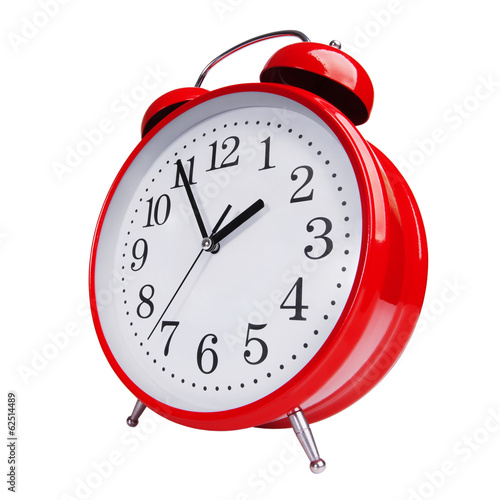 Red alarm clock on white background