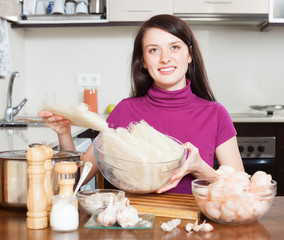 Smiling girl with ingredients for  rice noodles with seafood