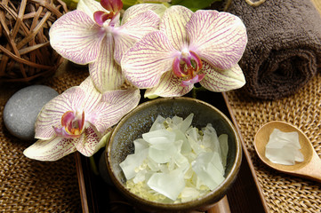 salt and orchid with towel with spa salt in bowl on mat