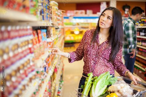Leinwanddruck Bild Buying food at the supermarket