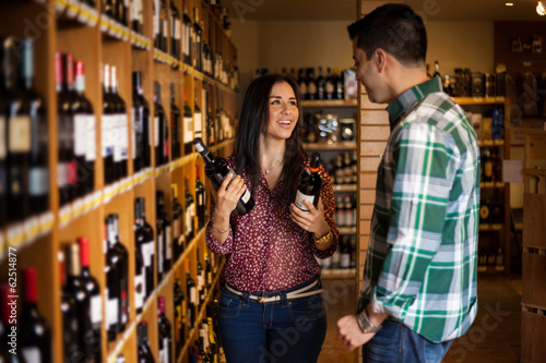 Happy couple buying some wine