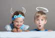 Girl with painted horns and an older boy with painted halo