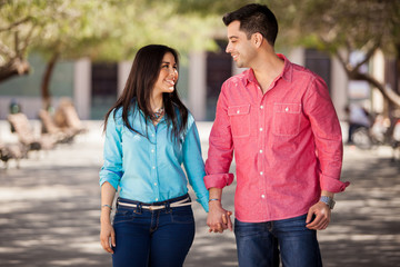 Cute young couple holding hands
