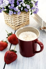 Cocoa with cream and strawberries