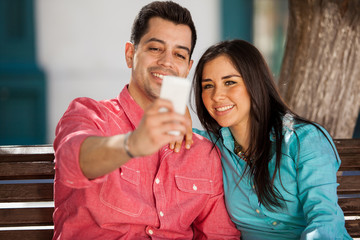 Cute couple taking a selfie