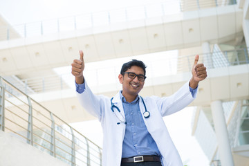 indian male doctor with two thumbs up