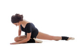 Resistant gymnast doing stretching exercises