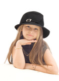 portrait of a little girl in a black hat