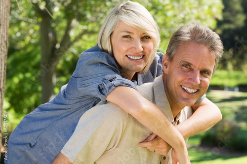 Man giving woman a piggyback ride