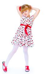 Charming little girl standing leg thrust forward and have fun lo
