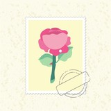 yellow postage stamp with rose and postmark