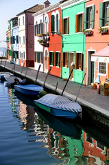 Colorful houses in front of a canal in Burano