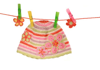 colorful hat on a clothesline  on white