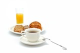 A cup of coffee, breakfast bread and a glass of orange juice