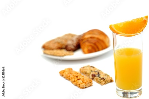 Breakfast bread, oat meal bars and a glass of orange juice