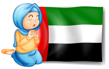 A girl in front of the United Arab Emirates flag