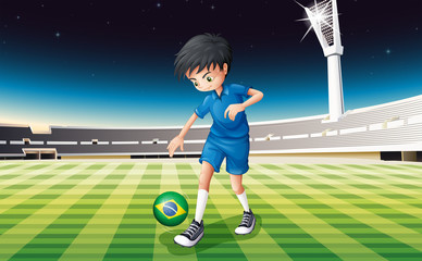 A soccer player at the field with the flag of Brazil