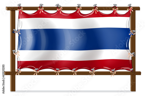 The flag of Thailand attached to the wooden frame