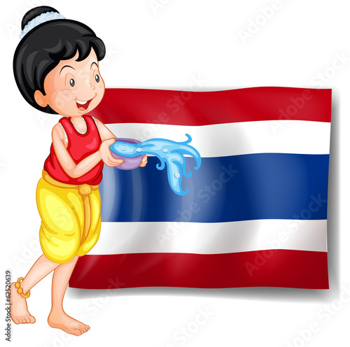 A smiling Thai woman in front of the Thailand flag