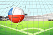 A ball hitting a goal with the flag of Chile