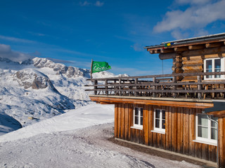 Mountain hut with terrace in winter time
