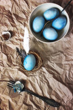 Blue easter eggs on a paper background. Rustic style.