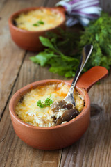 Roasted mushrooms in a pot with cheese