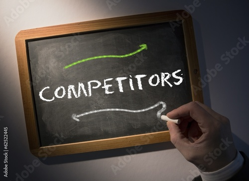 Hand writing Competitors on chalkboard