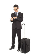 Young businessman using a cell phone  with briefcase