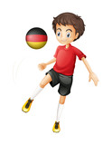 A boy using the soccer ball with the flag of Germany