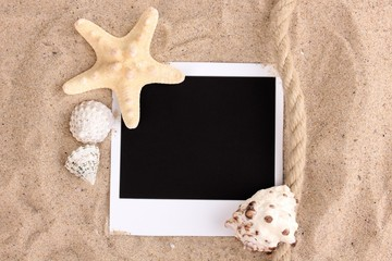 Photo with seashells and starfish on sand
