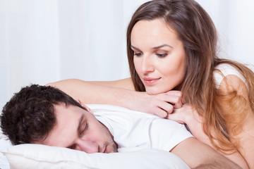 Sleeping man and pretty woman