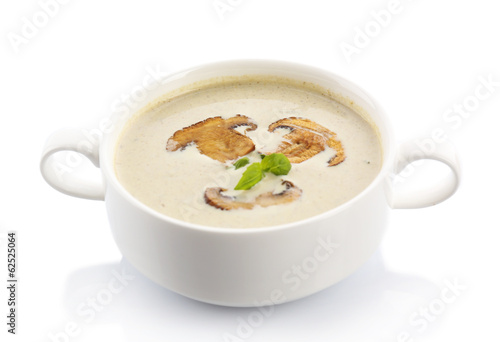 Mushroom soup in white bowl,, on plate, isolated on white