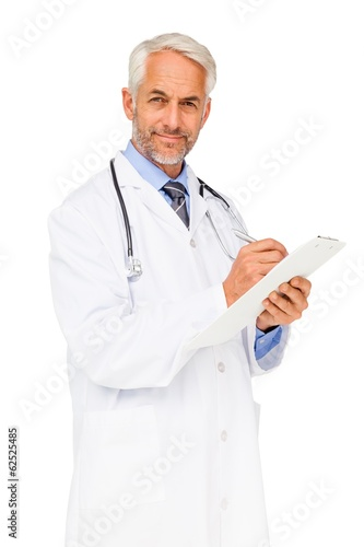Portrait of a confident male doctor writing reports