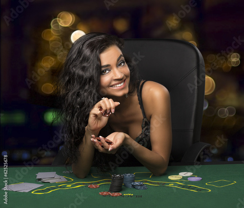 brunette girl in the casino playing poker