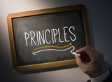 Hand writing Principles on chalkboard