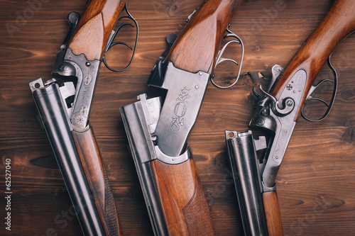 Shotgun  on wooden background - 62527040